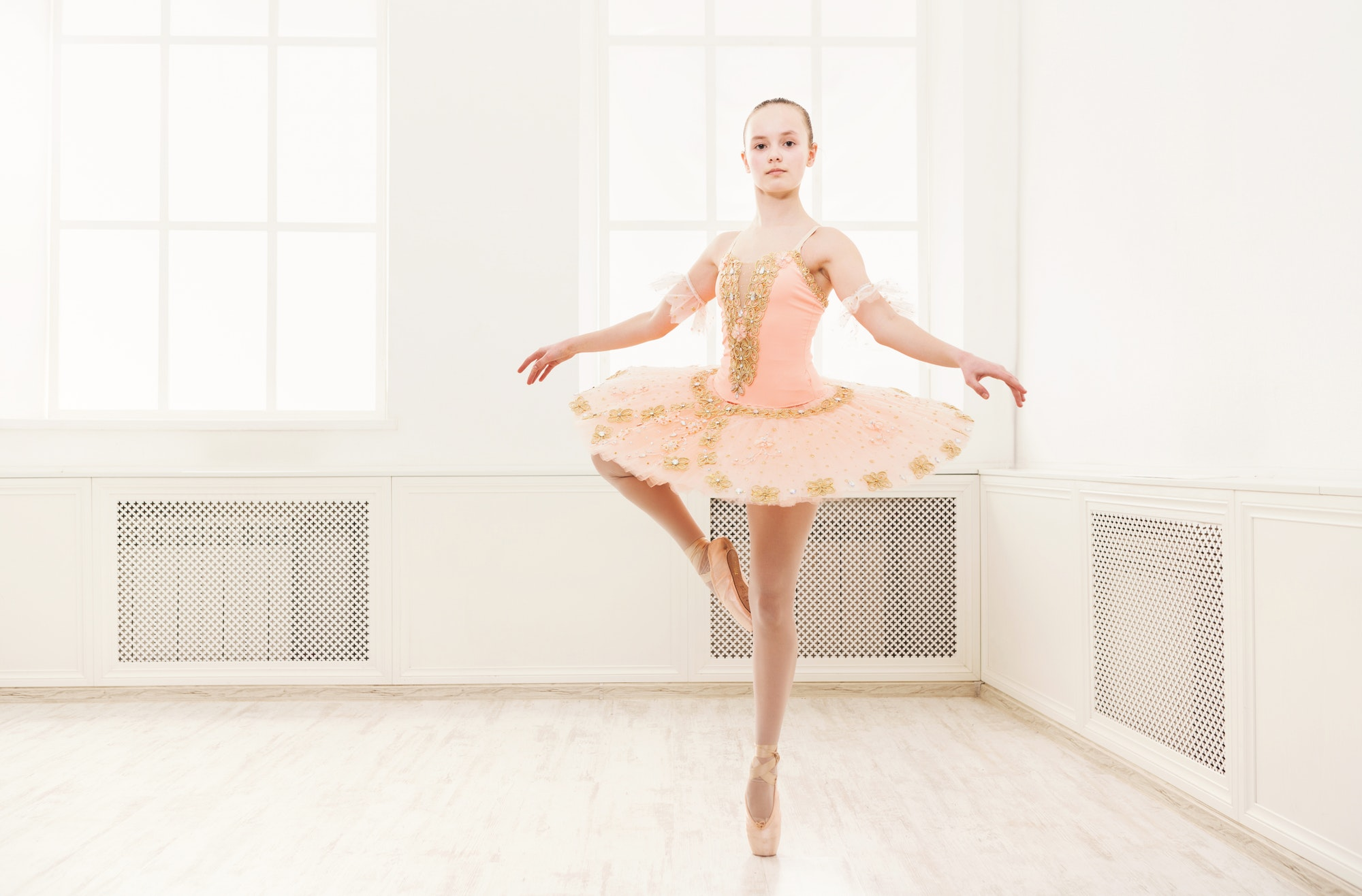 Ballet student exercising in ballet costume