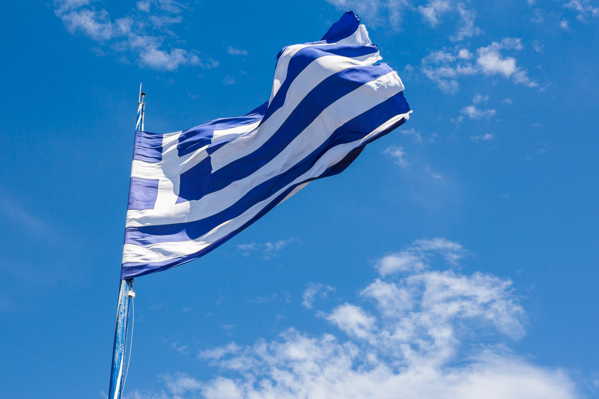 Greek biggest national flag waving in the sky in Keri in Zakynth
