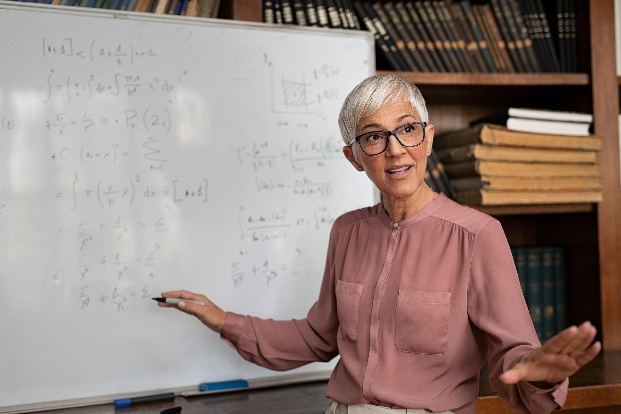 College professor explaining math