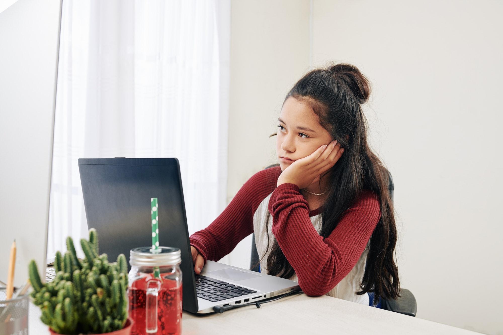 Girl installing program on laptop