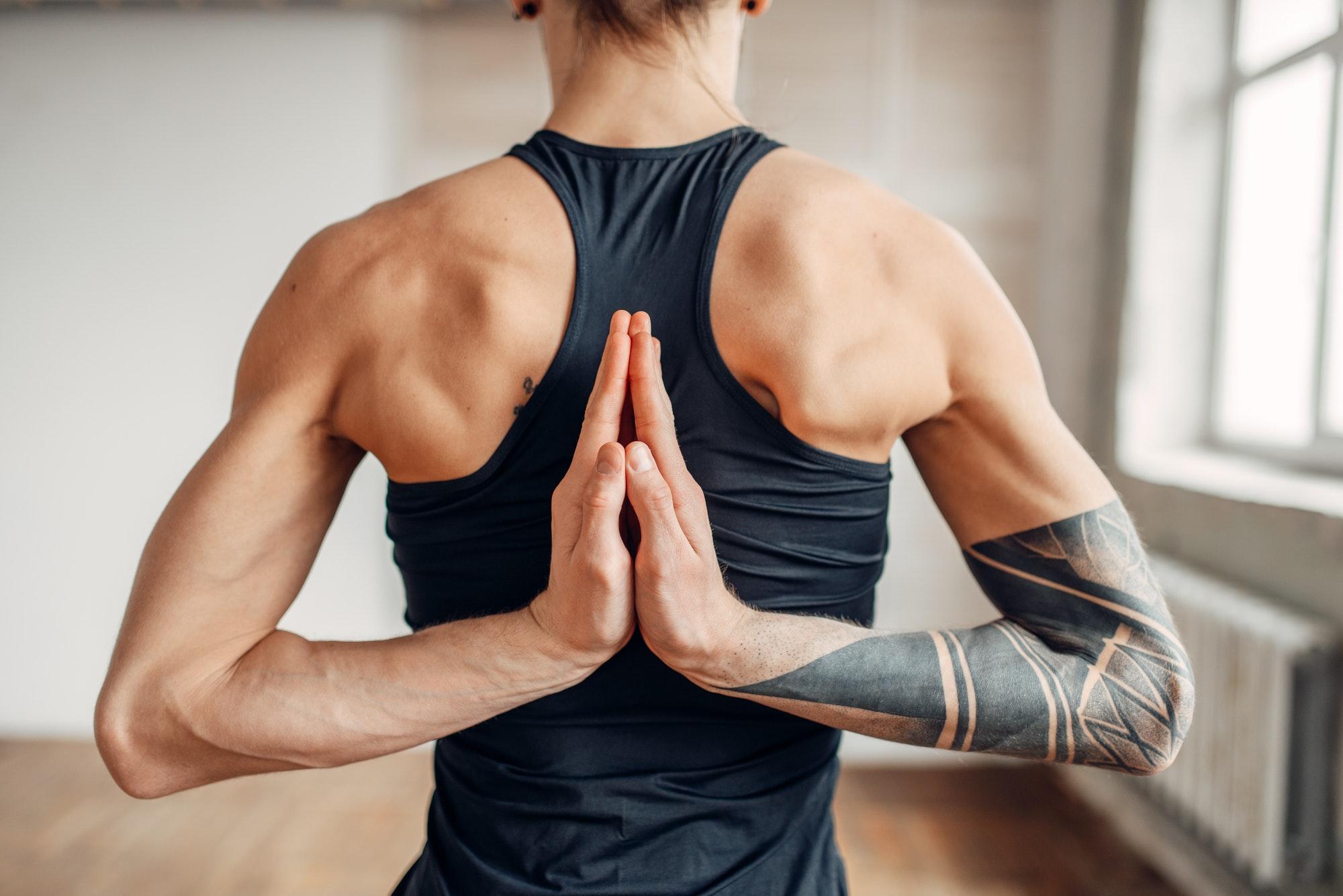 Male yoga on training, flexibility of human body