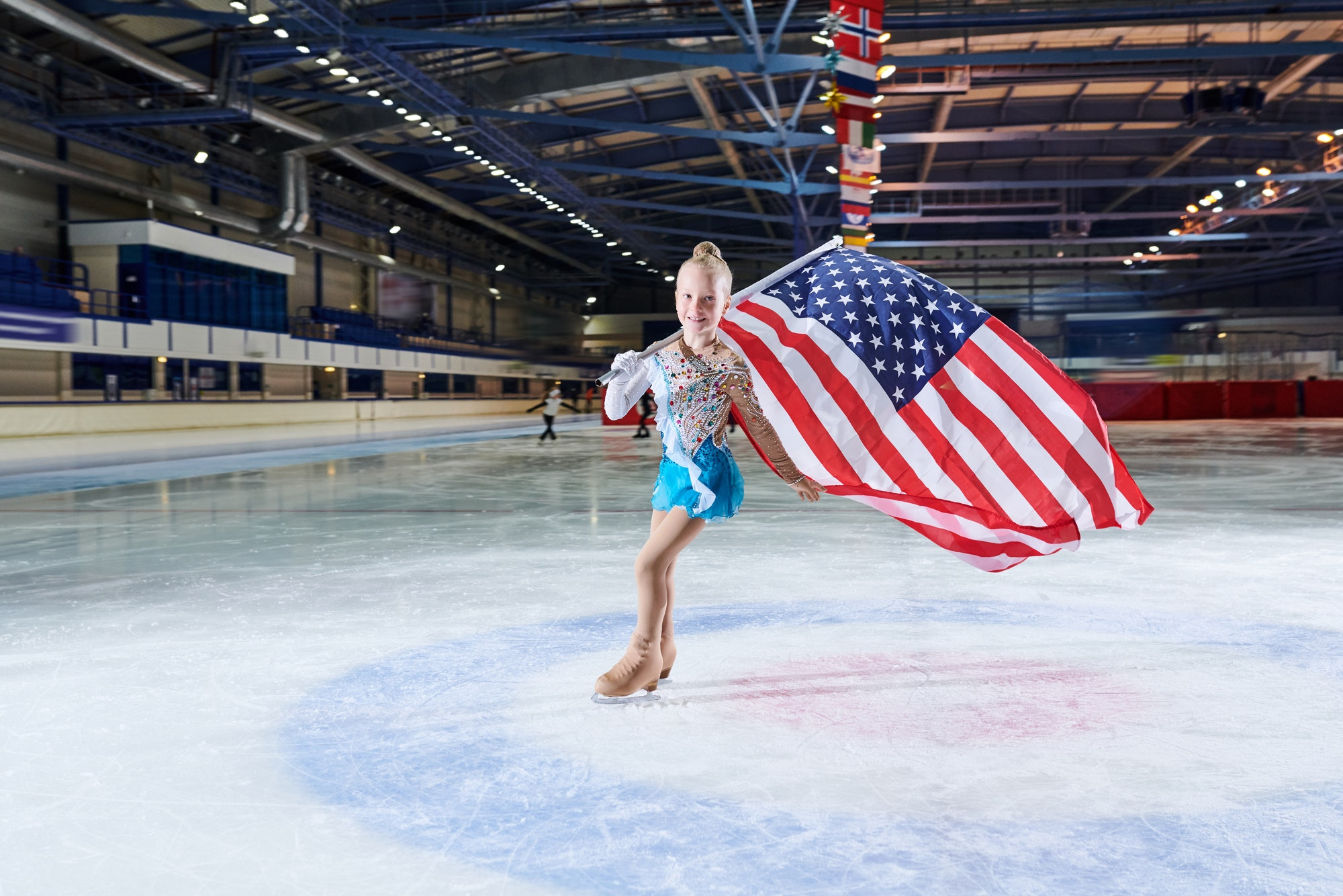 Little Girl Figure-Skating with American Flag